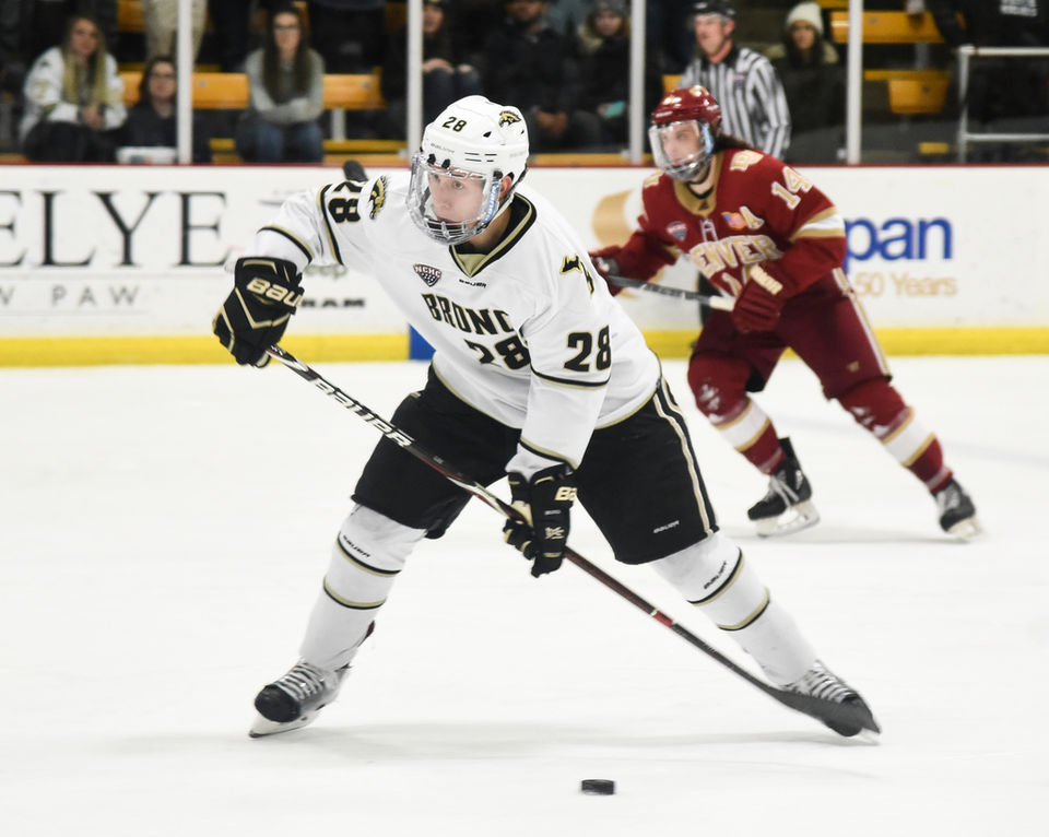 5782df24b Western Michigan left defenseman Cam Lee passes the puck during Western  Michigan's home game against the Denver Pioneers at Lawson Ice Arena in  Kalamazoo, ...