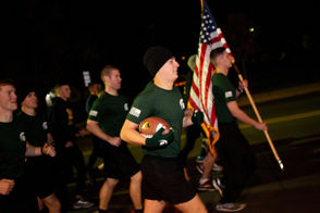 UM and MSU ROTC cadets run game ball 64 miles from Ann Arbor to East Lansing