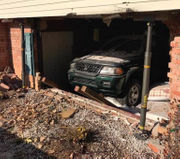 Woman backs car through wall of Palmer home, authorities say