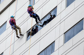 Participants in the Over The Edge rappelling event descend the Market Square Plaza building in downtown Harrisburg.