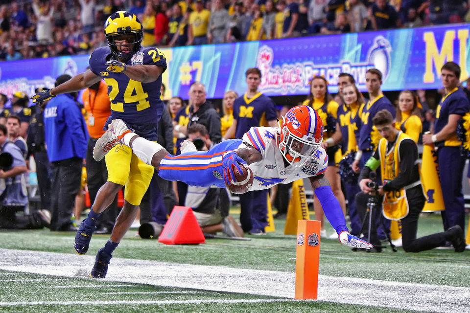 michigan loses to florida in the peach bowl finishes 10 3 on the