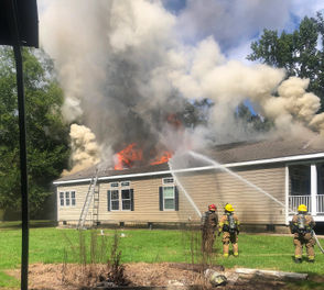 Fire badly damaged a house at 61005 Dogwood Drive, just north of U.S. 190, in Lacombe on Monday, Sept. 24, 2018.