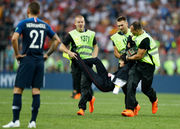 Here's why four people ran on the field during the World Cup final
