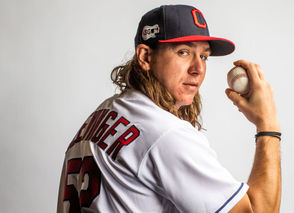"""CLEVELAND, Ohio — Coming off a season that saw him finish as one of only four American League pitchers to record at least 200 strikeouts and pitch 200 innings, Cleveland Indians starter Mike Clevinger is poised to join a class of elite pitchers in 2019. Clevinger went 13-8 with a 3.02 ERA, striking out 207 batters in 200 innings last year. He made his first career playoff start in Game 3 of the AL Division Series against Houston, pitching five innings and allowing just one run. MLB Network ranks the 28-year-old right-hander No. 82 among its Top 100 players in the game right now. He's one spot behind last year's AL Rookie of the Year, Shohei Ohtani, and he's 17 spots ahead of San Francisco's Madison Bumgarner and World Series hero David Price of Boston (Nos. 99 and 100 respectively). """"Sunshine,"""" as the Indians' social media accounts have taken to calling him in reference to his flowing locks of hair, has always marched to the beat of his own drum. In the past, he's clashed with the league's uniform police over his colorful cleats and clashed with opposing managers over his colorful glove. But along the way, he's developed into a consistent workhorse, whose mastery of off-speed pitches has made his fastball more dominant. A mechanical tweak midway through last season took things to the next level for Clevinger, and he's looking to ride that wave of success into 2019. The Jacksonville, Fla., native sat down during spring training this week to answer a handful of questions about his offseason, expectations for the Tribe's starting rotation and the different personalities in the clubhouse."""