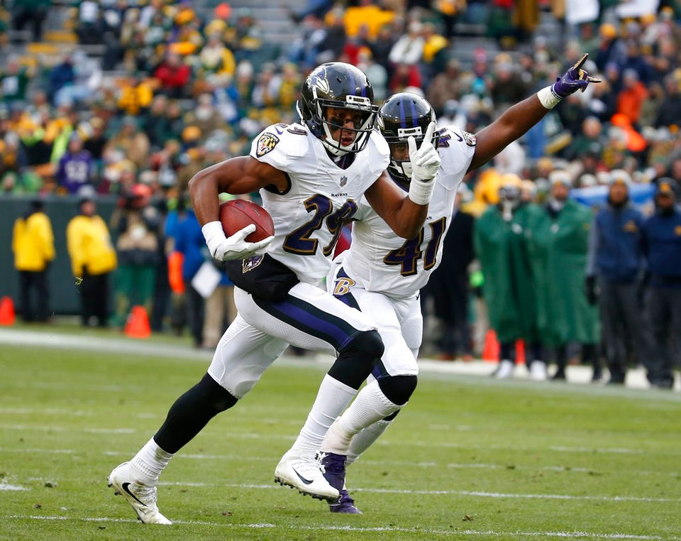 Baltimore Ravens' Marlon Humphrey celebrates his interception during the second half of an NFL football game against the Green Bay Packers Sunday, Nov. 19, 2017, in Green Bay, Wis. (AP Photo/Mike Roemer)