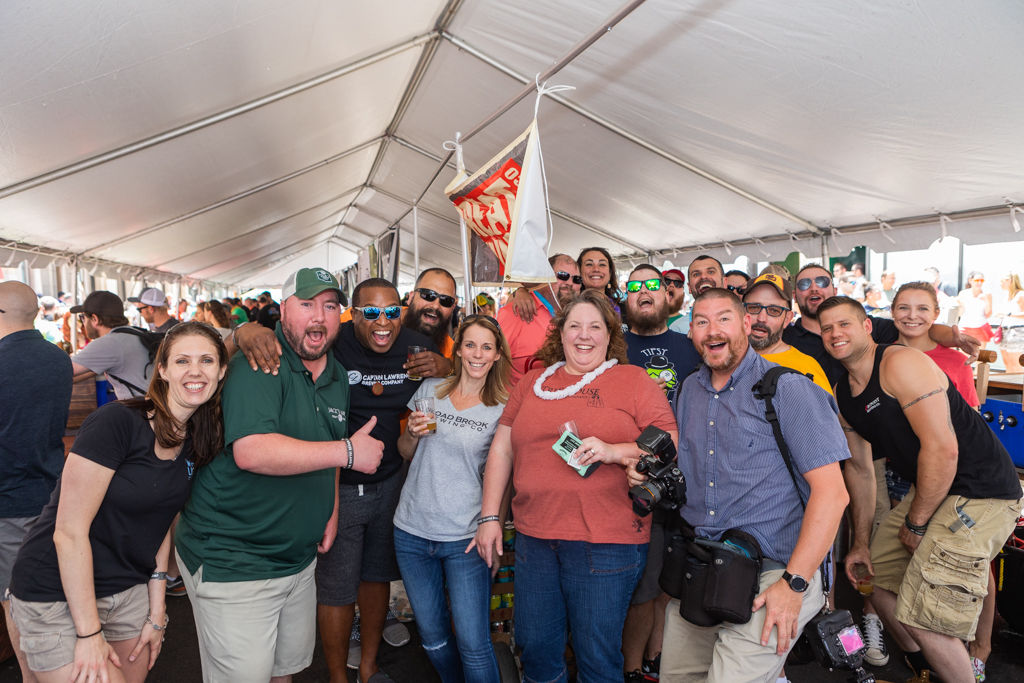 Staffs from various brewers get together for a group photo at 2018 Worthy Craft Beer Showcase festival on Worthington Street in Downtown Springfield on June 16 (Hoang 'Leon' Nguyen / The Republican)