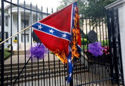 Activists burn Mississippi, Confederate flags outside governor's mansion: report