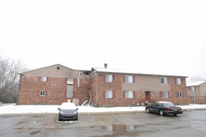 Officials are investigating a fire at Village Grove Apartments that left one person dead.
