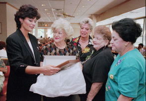 "Donna Russo choked up talking about Perkins. ""It was the best place to work. We became a family not only with our staff, but with our customers.""  In this image from 1999 she accepts a plaque from patrons."