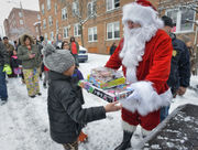 Holyoke Police join Santa to deliver toys to children in need on Christmas