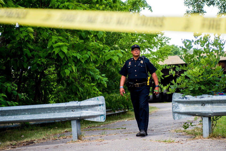 Flint Police investigate after two bodies were found along the bank of the Flint River on Thursday, July 12, 2018 under the I-475 overpass near the intersection of Lyman Street and Riverside Drive on Flint's east side. Jake May | MLive.com
