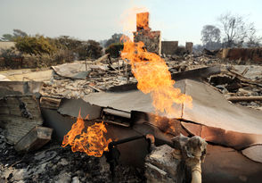 The wildfire in Southern California is one of two devastating wildfires on the west coast. Here is some of the damage.