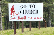 Iconic 'Go to Church or Devil Will Get You' sign is restored to its place along I-65