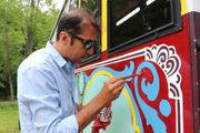 Pakistani artists give Amherst BID trolley a makeover