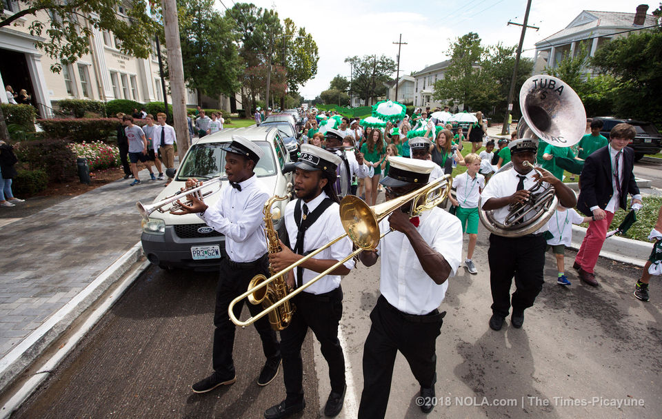 Newman students and staff celebrate reopening of Jefferson Ave. with a second-line