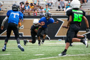 Youth football players team up with Kalamazoo Public Safety at jamboree