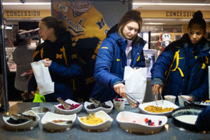 University of Michigan student-athletes take advantage of a grab-and-go breakfast on Dec. 13, 2018.