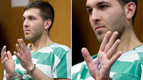 """Anthony Comello, 24, of Eltingville, was arrested Saturday in New Jersey in the vicinity of a blue pickup truck police say was seen leaving the crime scene. During an extradition hearing Monday, Comello appeared in court with the words """"MAGA forever,"""" and what appears to be a reference to QAnon in blue ink on his hand. MAGA, of course, refers to President Trump's campaign slogan """"Make America Great Again."""" And QAnon a nod to a conspiracy theory that posits, among other things, Trump is attempting to save the planet from a global pedophile human trafficking ring that involves high-ranking politicians and Hollywood figures."""