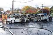 Several cars burn in parking lot after utility pole crash exposed wires