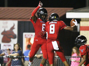 Spanish Fort's Zavier Love (6) congratulates Spanish Fort wide receiver Kaleb Purdie (8) after his touchdown against St. Paul's in the first half of a prep football game Friday, Oct. 5, 2018, in Spanish Fort, Ala. (Mike Kittrell/preps@al.com)