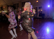 PAWS benefit celebrates the 70's at Decade Dance: see photos