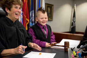 Children are adopted in the Saginaw, Bay City and Flint areas on adoption day, Tuesday, Nov. 20, 2018.
