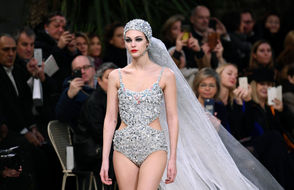 Italian model Vittoria Ceretti presents a creation by Chanel during the 2019 Spring-Summer Haute Couture collection fashion show at the Grand Palais in Paris, on January 22, 2019.