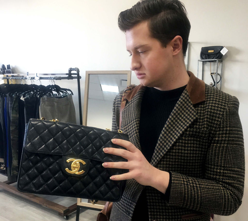 03d4f61e4bfb Morgan examines a classic Chanel flap bag at The Style Loop in Rocky River.  (Allison Carey/The Plain Dealer)