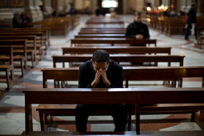 A priest prays inside the Church of Saint Ignatius, dedicated to Ignatius of Loyola, the founder of the Jesuit order, in Rome, Italy, in this 2013 file photo. Thursday, March 14, 2013.