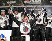 Harvick adds Cup win to dominant weekend at Atlanta; salutes Dale Earnhardt