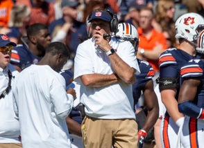 Auburn head coach Gus Malzahn looks on during the first half the Tigers' loss to Tennessee last weekend.