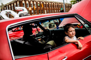 The event includes children to those young at heart and entire families. Lucas Pfeiffer, 3, (pictured here) looks out the window of a 1968 Chevrolet Impala parked on Saginaw Street just south of Third Street on Saturday, Aug. 19, 2018 in downtown Flint. Gordon Pfeiffer, 28, of Davison drove the vehicle to the event. Mark Pfeiffer, Gordon's father, has the same vehicle. The Impala was built at General Motors Truck and Bus Fisher Body plant and still has the original engine and paint job. Have a look at the family's story here: Family tradition as rich classic car love at 14th annual Back to the Bricks