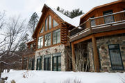 $1.19M log-clad home offers rustic luxury on inland lake