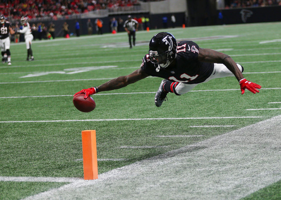 Atlanta Falcons wide receiver Julio Jones (11) scores a touch down against the Tampa Bay Buccaneers during the first half of an NFL football game, Sunday, Nov. 26, 2017, in Atlanta. (AP Photo/John Bazemore)
