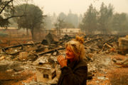 In smoldering California wildfire ruins, life goes on for a hardy few