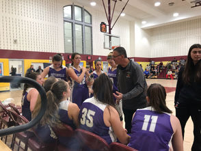 Tottenville coach Ron Nathanson tries to rally his team, which trails 28-16 late in the first half.