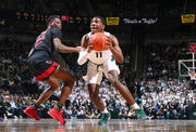 Michigan State overcomes sluggish start to top Rutgers, stay in first place