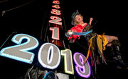 Revelers say hello to 2019, goodbye to an unsettling 2018: See photos