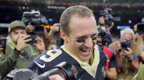 """When I told Drew Brees the premise of this column, he didn't want to hear it. """"La la la,"""" he said, jokingly putting his fingers in his ears as he walked away. I understand. I'm a superstitious person, too. However, it's time to discuss whether or not Brees is in the midst of the greatest season by a quarterback in NFL history. Many people consider Aaron Rodgers' performance in 2011 with the Packers to be the best of all time, but through nine games in 2018, Brees has been better by just about every key metric. Now, before going further, it's important to note there are countless ways by which to judge a quarterback. Yards, touchdowns, interceptions, yards per attempt and completion percentage are among the most basic stats. Passer rating and ESPN's total QBR are a bit more analytical. There's also the physical traits by which scouts evaluate quarterbacks like height, weight, speed and arm strength, and intelligence is a top quality, too. Once guys are established in the NFL, however, those matter a lot less. There's also the fan favorite of quarterback wins. This is impossible to truly judge because quarterbacks with better surrounding casts typically have a better chance to succeed. However, Brees says wins is the only stat that matters to him, and most quarterbacks are judged on championships. Personally, I tend to favor passer rating, yards per attempt and touchdown-to-interception ratio when evaluating quarterbacks in a given season, and then Super Bowl titles matter a lot when discussing signal callers historically. Passer rating is flawed because it doesn't account for a quarterback's runs. Total QBR does consider rushing, but it's easy to dismiss that stat as flawed when Case Keenum ranked second behind Carson Wentz last year. With all that in mind, let's look at Rodgers' totals in all of 2011 versus Brees through nine games this year. Rodgers: 4,643 yards, 68.3 percent completions, 45 touchdowns, 6 interceptions, 7.5 TD-INT ratio, 9.2 yards per attempt, 122."""