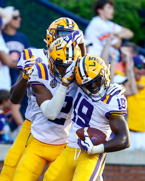 LSU wide receiver Derrick Dillon (19) celebrates with teammates after scoring a touchdown during the second half of an NCAA college football game against Auburn, Saturday, Sept. 15, 2018, in Auburn, Ala. (AP Photo/Butch Dill) AP