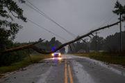 Florence, now a tropical storm, besieges Carolinas