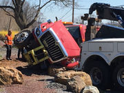 Dump truck rolls over, dumps asphalt, shuts road
