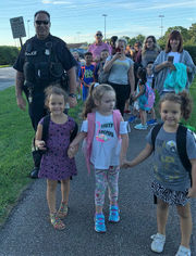 Parents walk their kids to school in Berea: Community Voices