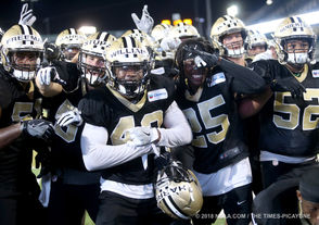 Staff photographers David Grunfeld and Michael DeMocker favorite photos from first half of Saints training camp.