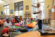 Chuck Perkins entertains kids with poetry at Hubbell Library