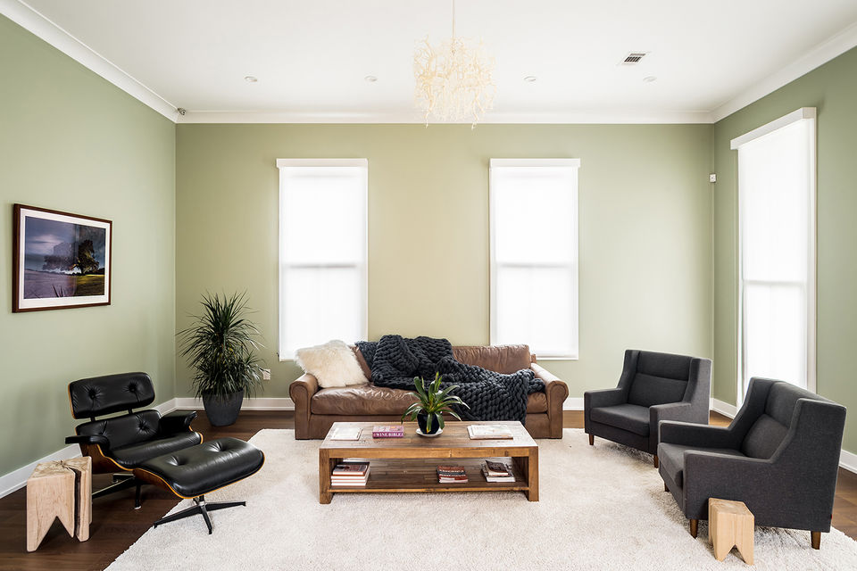In The Living Room A Leather Sofa From Restoration Hardware Is Paired With Knock Off Eames Lounge Chair And Two Matching Charmichael Chairs Gus