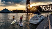 First standup paddle race on Cuyahoga, Blazing Paddles,  to showcase shipping and recreation sharing river