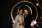 Nick Jonas and Priyanka Chopra show off wedding scenes, featuring 75-foot veil and house-sized cake