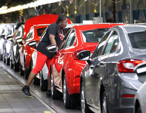 Workers put the final touches on the Cruze cars at the GM Lordstown Complex on Thursday, Oct. 4, 2018. Cruze sales soared to more than 300,000 in 2014. But recent October's quarterly sales showed a drop of 27 percent.