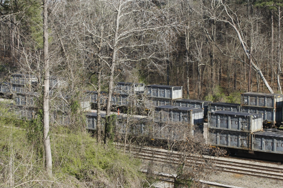 The containers are loaded off the trains onto trucks for transport to the Big Sky Environmental landfill in Adamsville.
